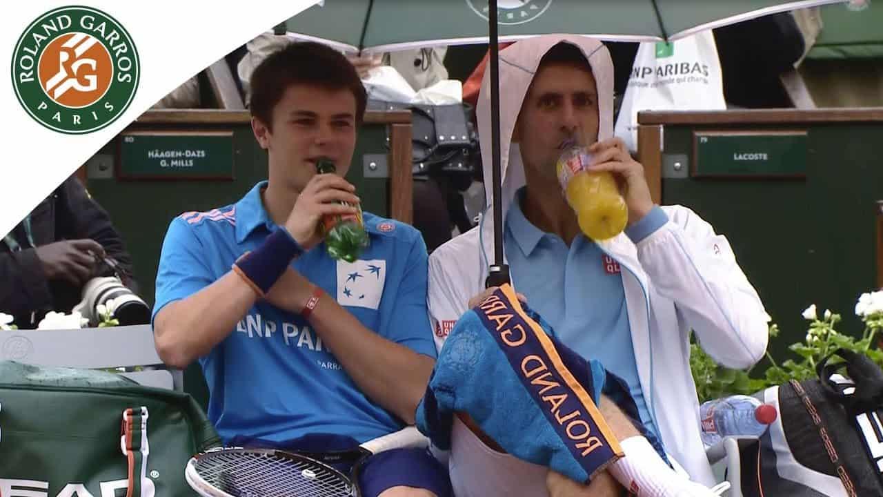 Novak Djokovic with ball boy image