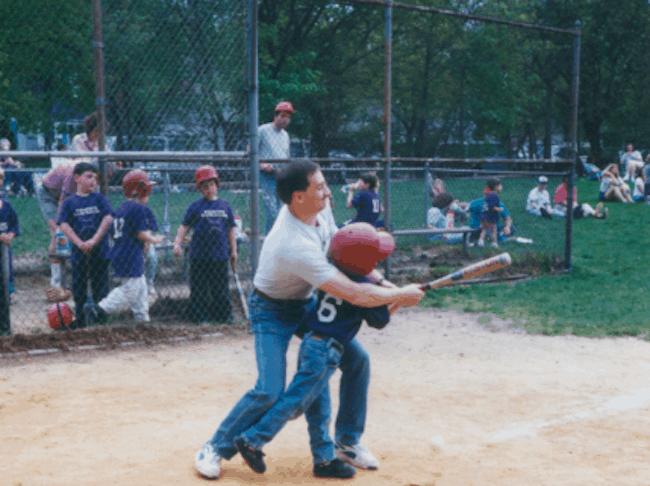Dad and son playing baseball image
