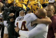Casey O'Brien and Coach Fleck share a hug image