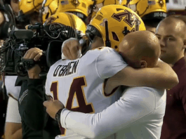 Casey O'Brien and Coach Fleck share a hug image